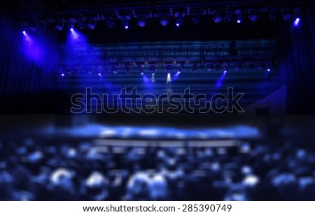 Audience in a theater, on a concert blurred - stock photo