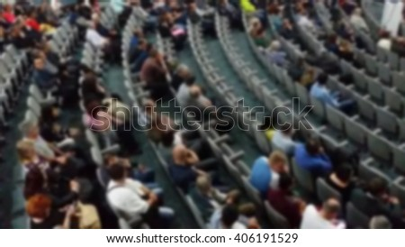 Audience in a theater, on a concert. Viewers watching the show.
