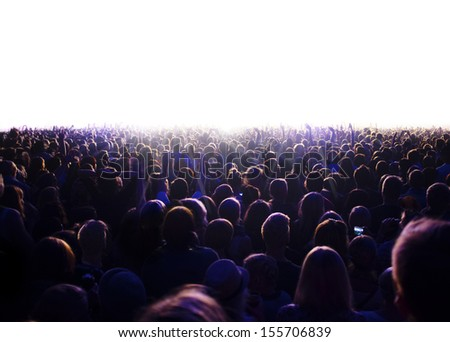 Audience is watching a luminous surface. - stock photo