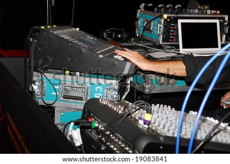 Audio and video mixing console operated by man - stock photo