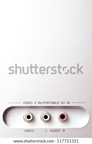 Audio and video sockets on the back of a stereo amplifier - stock photo