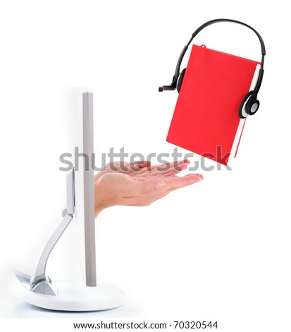 Audio book concept - computer screen and empty hand with red book with headphones - stock photo