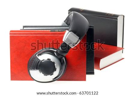 audio book concept (headphones and books) - stock photo