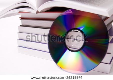 Audio book concept - pile of books and one cd over white - stock photo