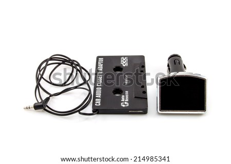 Audio Cassette adapter and car FM transmitter - stock photo