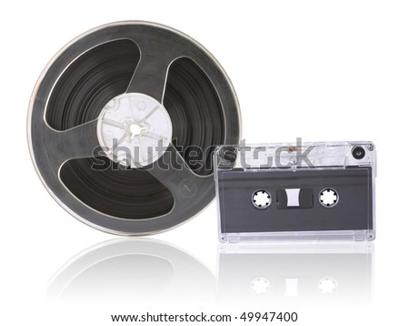 audio cassette and bobbin with magnetic tape are isolated over white - stock photo