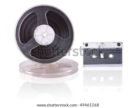 audio cassette and bobbins with magnetic tape are isolated over white - stock photo