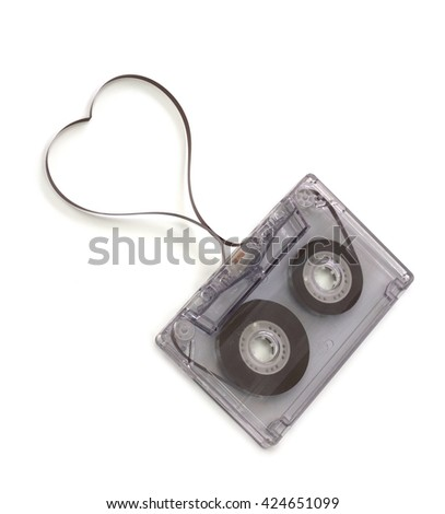 Audio cassette and heart shape with tape strip isolated on white