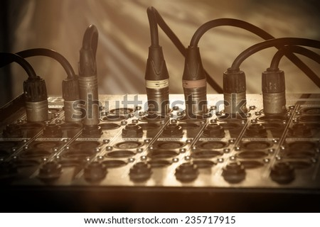 Audio connectors in sound mixed controller,vintage filtered color. - stock photo