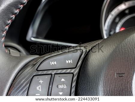 audio control switch on steering wheel - stock photo