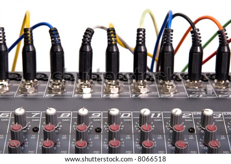Audio mixboard closeup with wiring connections isolated over white - stock photo