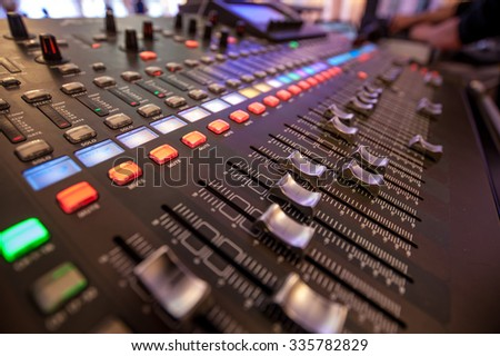 Audio mixer and microphone - stock photo