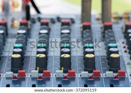 audio mixer for meeting to develop the organization. Detail of a music mixer in studio, dj working for a new song