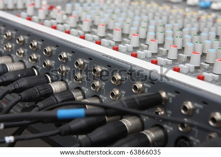 Audio mixer with wires, on open air. - stock photo