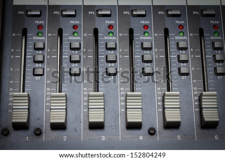 Audio mixing console in a recording studio. Faders of a sound mixer - stock photo