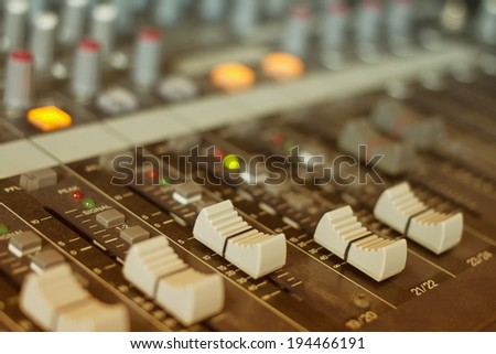audio mixing console with faders and adjusting  - stock photo