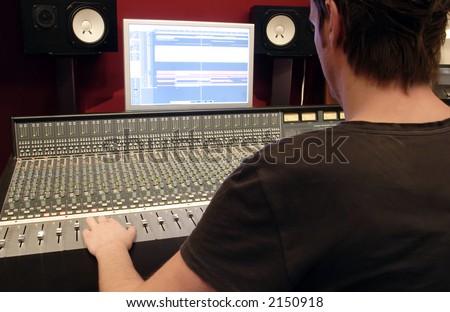 Audio Mixing panel with operator - stock photo