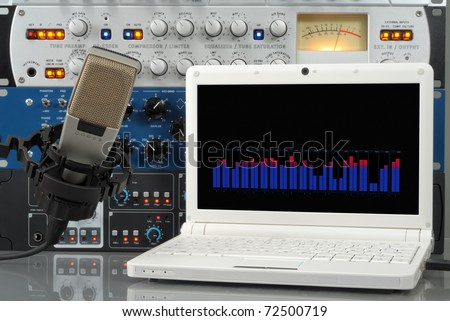 Audio setup containing microphone, laptop and other professional sound design devices - stock photo