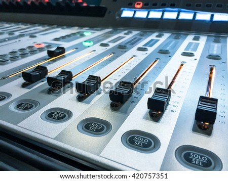 audio sound digital mixer with buttons and sliders,close-up,vintage color - stock photo