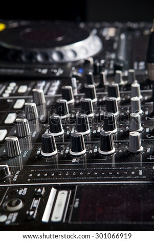 Audio sound mixer with buttons and sliders - stock photo