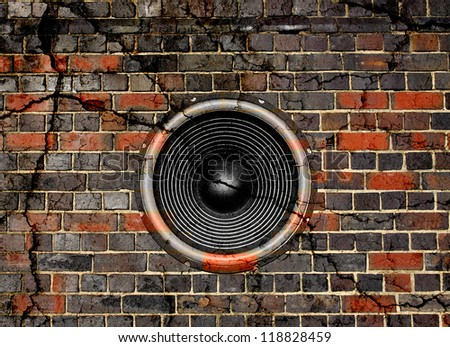 Audio speaker on a cracked brick wall background - stock photo