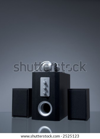 Audio speakers on the gray background with reflection