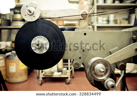 Audio video industrial film synchronizer for movie post production in old factory, vintage movie processing - stock photo