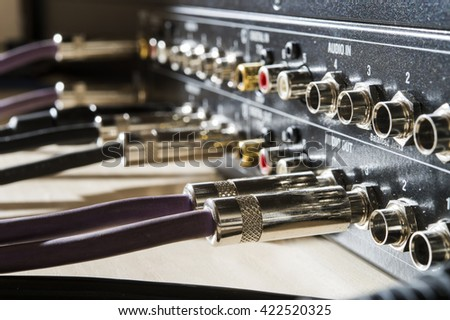 audio wires in the mixer - stock photo