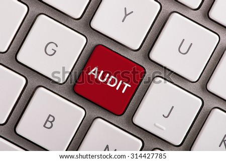 Audit button on white computer keyboard