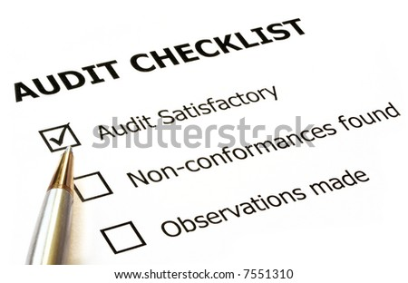 "Audit checklist with silver and gold ballpoint.  Check in ""audit satisfactory"" box. - stock photo"
