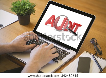 audit. Close-up top view of man working on laptop. all screen graphics are made up. - stock photo