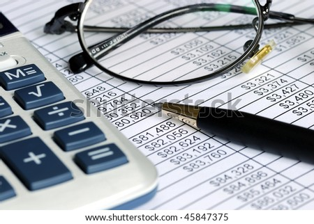 Audit the numbers listed on the spreadsheet - stock photo