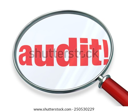 Audit word under a magnifying glass to illustrate accounting or bookkeeping rules or regulations you must follow for your home, personal or business finances - stock photo