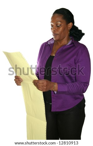 auditor analyzing data on paper - stock photo