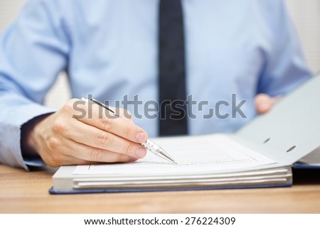 auditor is examining articles of agreement - stock photo