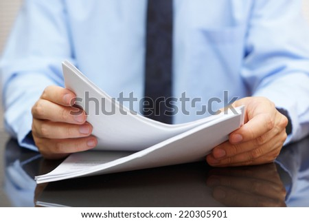 Auditor is reading documentation - stock photo