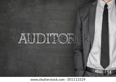 Auditor on blackboard with businessman in a suit on side - stock photo