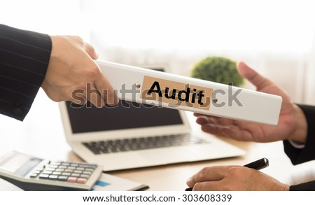 Auditor sends file audited financial statements of the Company to executives. - stock photo