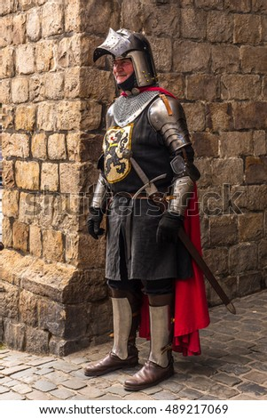Aug, 2015 - Gent, Belgium: Medieval knight keeping guard on the Catle of the Earls of Gent.