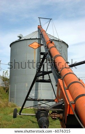 Auger and Grain Bin During Harvest - stock photo