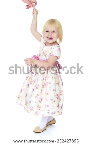 aughing blonde little girl holding her mother's finger.Isolated on white.