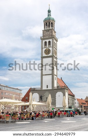 AUGSBURG, GERMANY - APRIL 11: Tourists at the Rathausplatz in Augsburg, Germany on April 11, 2015. Augsburg is one of the oldest cities of Germany. - stock photo