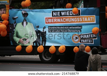 "AUGUST 30, 2014 - BERLIN: a political poster of the ""Piratenpartei"" with the typical appearance of Chancellor Angela Merkel with a surveillance camera as a head, demonstration against surveillance. - stock photo"