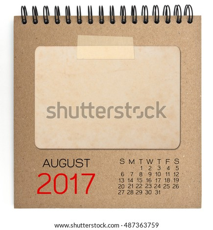 August 2017 calendar on brown notebook with old blank photo