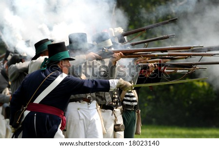 August 9/2008- Fort Erie, ON, Can.: American troops fire on the British during the 22nd Annual Siege of Fort Erie weekend, a War of 1812 reenactment. - stock photo