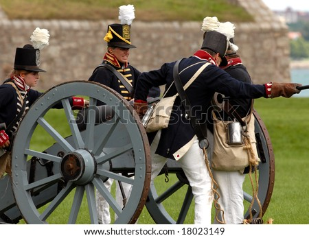August 9/2008- Fort Erie, ON, Can.: An American gun crew prepares to fire during the 22nd Annual Siege of Fort Erie weekend, a War of 1812 reenactment. - stock photo