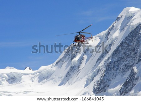 AUGUST 2009 - GORNERGRAT: a Helicopter at the Gornergletscher (Gorner Glacier) in the Swiss Alps. - stock photo