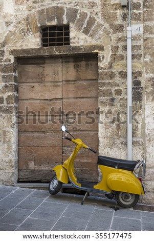 August 11, 2015 Gubbio (Italy) - Famous Italian scooter parked in a street of the ancient town of Gubbio in Umbria