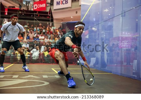 AUGUST 21, 2014 - KUALA LUMPUR, MALAYSIA: Mohamed El Shorbagy (black shirt) of Egypt plays Mohd Nafilzwan Adnan of Malaysia at the CIMB Malaysian Open Squash Championship 2014 held in Nu Sentral Mall. - stock photo