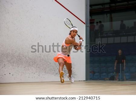 AUGUST 19, 2014 - KUALA LUMPUR, MALAYSIA: Nicol David (Malaysia) hits a back hand return her match in the CIMB Malaysian Open Squash Championship 2014. - stock photo